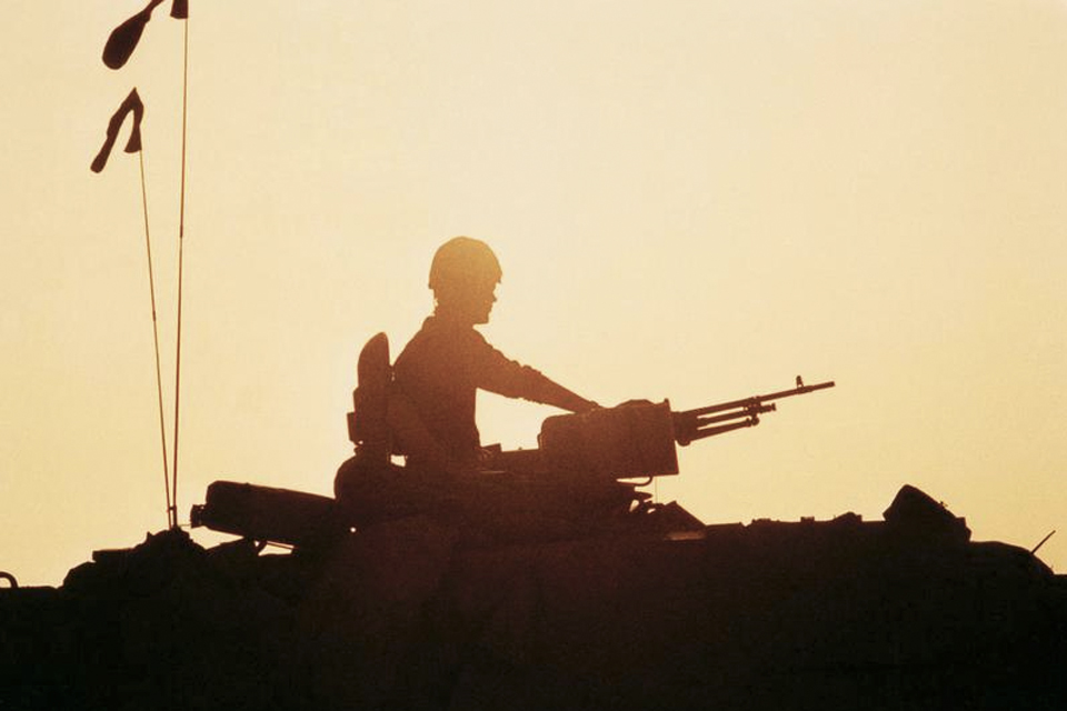 Silhouette of a British Challenger tank commander during the Gulf War, 1991