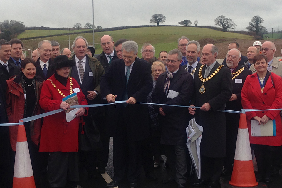 Roads Minister Andrew Jones, cutting the ribbon at the road opening.