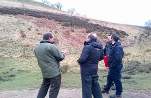 Sir James Bevan being shown the Clough Woodland tree planting scheme in the Peak District