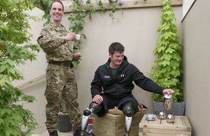 Major Peter Le Feuvre (left), a military physiotherapist, and Captain David Henson, a Royal Engineer from 22 Engineer Regiment, at the debut of Headley Court's Courtyard Garden at the Royal Horticultural Society's Chelsea Flower Show
