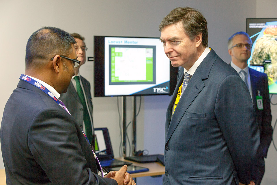 Defence Minister Philip Dunne speaks to Afzal Ali, Capability Development Leader - Synthetics & Intelligent Systems, UK Defence Solutions Centre.