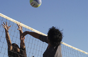 An Afghan soldier faces up to the net against a soldier from the Royal Gurkha Rifles during the first Babaji volleyball tournament at Patrol Base Nahidullah