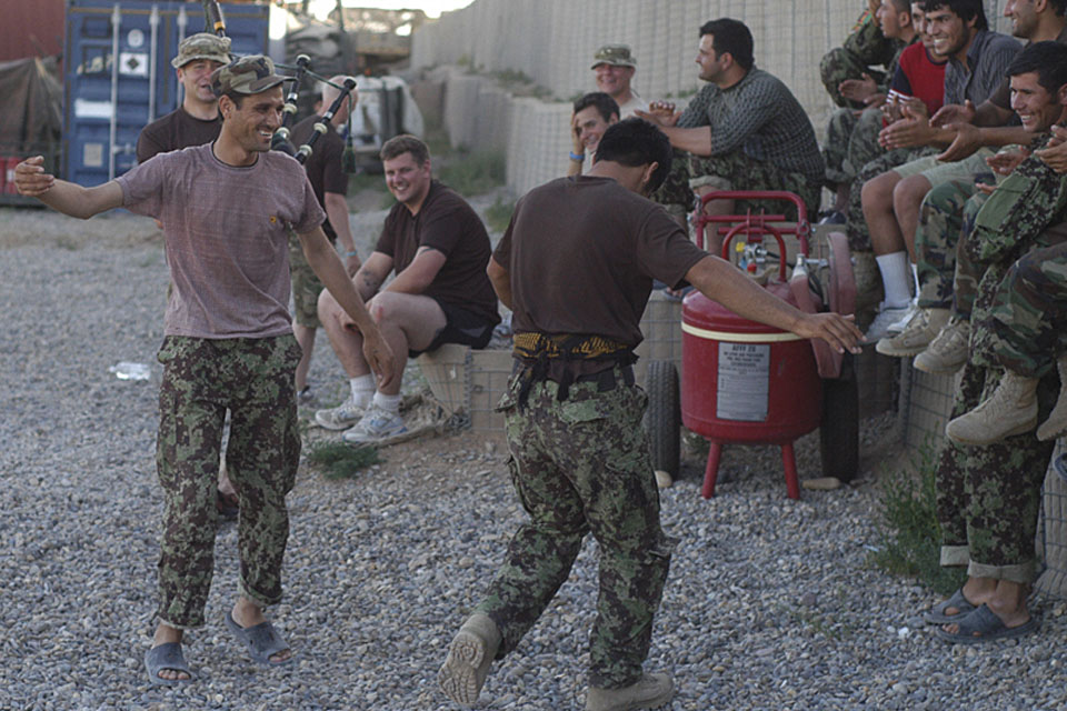 Soldiers from 4th Battalion The Royal Regiment of Scotland teach their Afghan National Army colleagues how to do the Highland Fling ahead of the volleyball tournament at Patrol Base Nahidullah