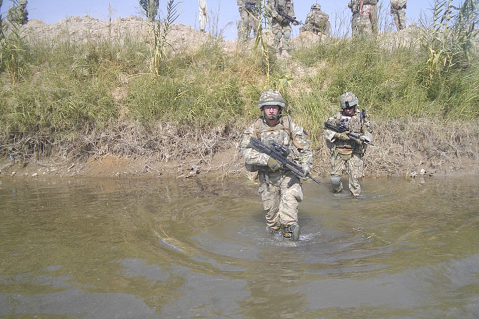 Soldiers from C Company, 1st Battalion The Princess of Wales's Royal Regiment, wade into a river during Operation TORA GHAR