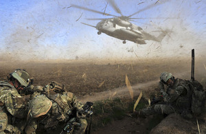 Troops protect their eyes from the debris kicked up by a descending helicopter