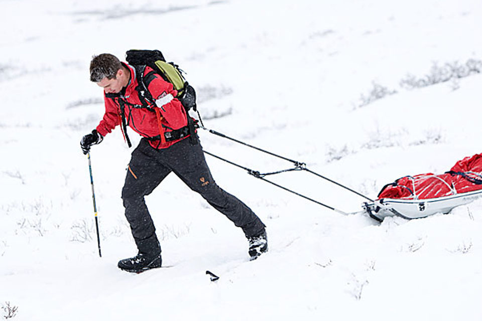 Private Jaco van Gass pulls his sledge across the snow during Arctic training