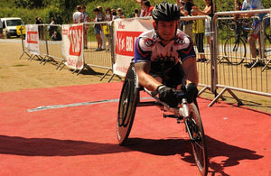 Joe Townsend crosses the finish line in his racing wheelchair at the Cotswold 113 event - a half Iron Man race
