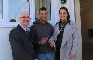DIO Army Basing Programme Director Mark Duddy presents keys to Lance Corporal Luke Tierney and Christine Tierney to their newly refurbished home