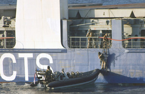 Royal Marines from HMS Montrose board MV Beluga Fortune after an attack by armed pirates in the Indian Ocean
