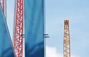 Cranes against sky