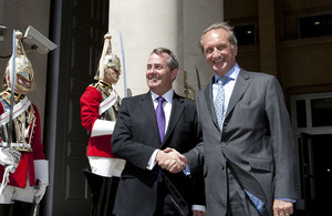 Dr Liam Fox (left) shakes hands with French Defence Minister Gérard Longuet outside the UK Ministry of Defence headquarters in London