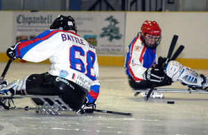 Players from the Battle Back Bisons, an ice sledge hockey team made up from injured military personnel, in action at the Planet Ice Arena in Basingstoke