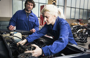 Apprentice mechanic working on a car engine