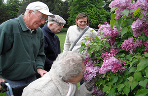 A group of people who are living with dementia enjoy a sensory experience in the great outdoors