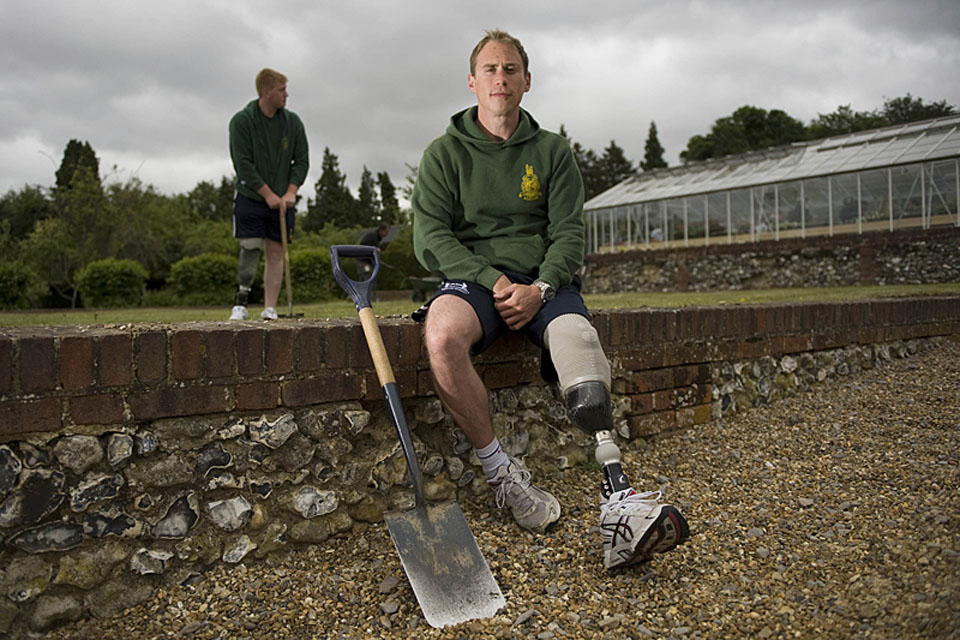 Marine Tristan Sykes, 30, from Norwich, outside the new greenhouse project at Headley Court