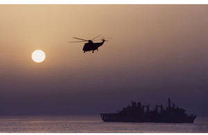A Fleet Air Arm helicopter flies over RFA Fort Victoria