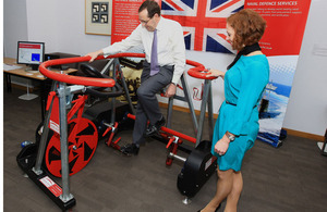 Minister for Defence Equipment, Support and Technology Peter Luff tries out an exercise bike, modified for use by injured Service personnel, at the Centre for Defence Enterprise exhibition