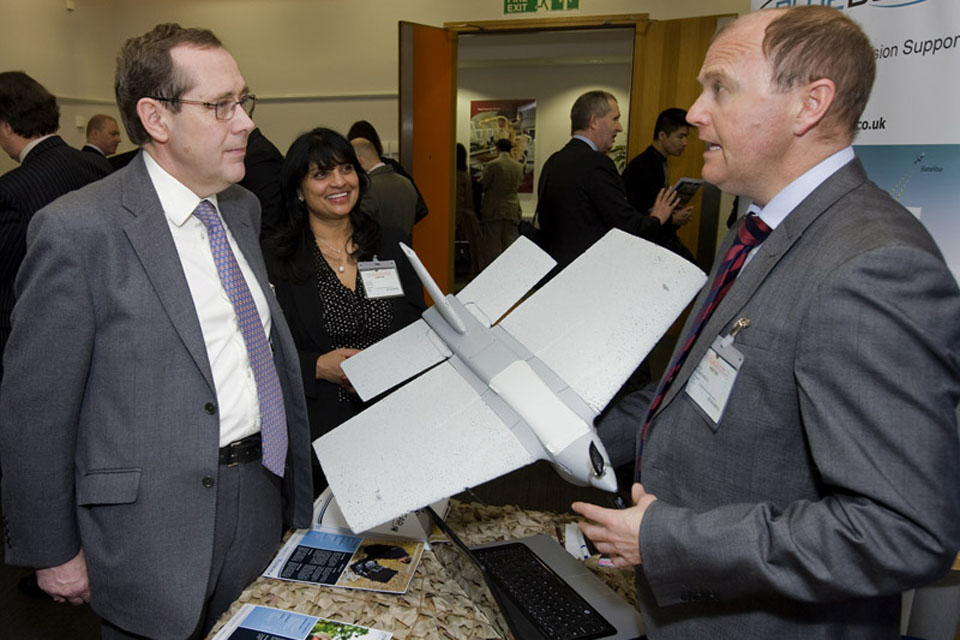Minister for Defence Equipment, Support and Technology Peter Luff talks to a representative from Blue Bear Systems Research, who have developed a lightweight unmanned air vehicle system