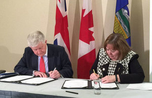 British High Commissioner Howard Drake and Alberta Energy Minister Margaret McCuaig-Boyd sign a UK-Alberta Low Carbon Innovation and Growth Framework.