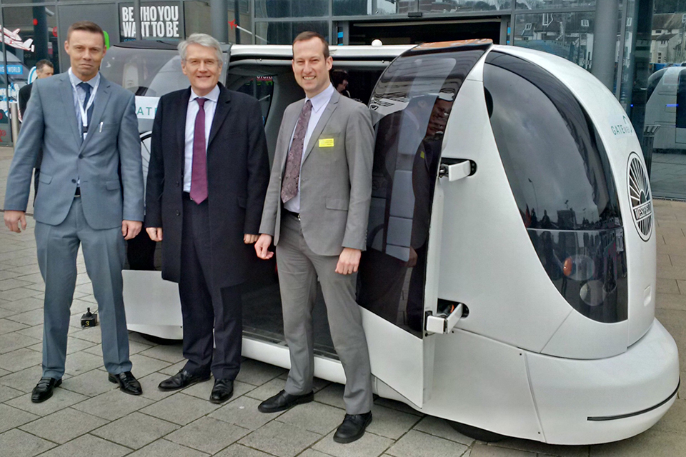 Transport Minister Andrew Jones and a driverless car.