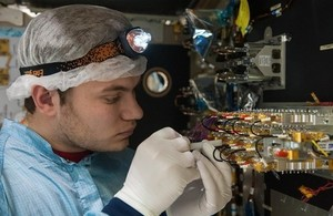 Engineer working on a satellite.