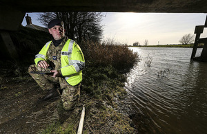 Corporal Paul 'Barney' Barnard from RAF Marham conducts flood defence surveys around the town of Earith on behalf of the Environment Agency.