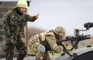 A member of the Royal Air Force Regiment instructing a member of the Tonga Defence Services at RAF Honington