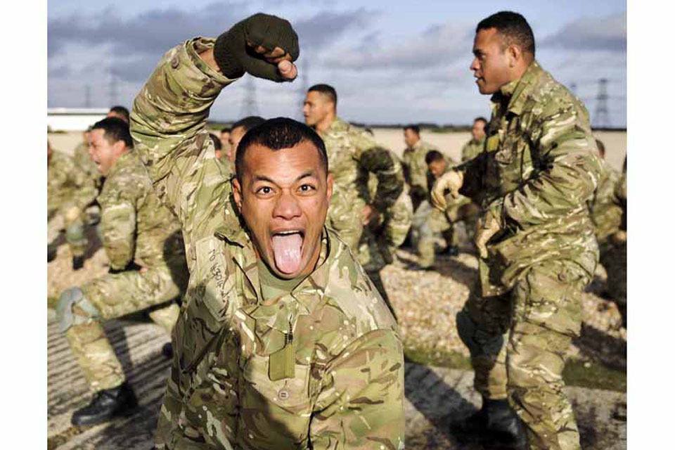 A Tongan shows his 'war face' while performing the Sipi Tau war dance during training at RAF Honington