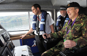General Sir David Richards takes the controls of a patrol vessel