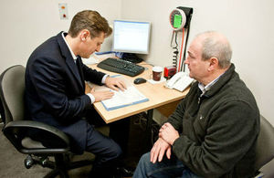 GP consulting a patient