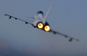 An RAF Typhoon pilot applies the afterburners as the aircraft takes off (stock image)