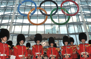 Bandsmen and women from the Band of the Irish Guards beneath the newly-unveiled Olympic Rings at London Heathrow's Terminal 5
