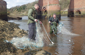 Officers pull net from river