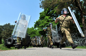 Soldiers from No 1 Company of the Irish Guards, with Perspex riot shields, helmets and batons, train to enforce public order