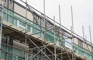 Exterior view of Beattie Passive construction with scaffolding