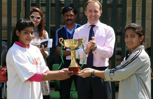 Mr. Thomas Drew CMG, British High Commissioner-Designate, with captains of the under 14 girls football teams