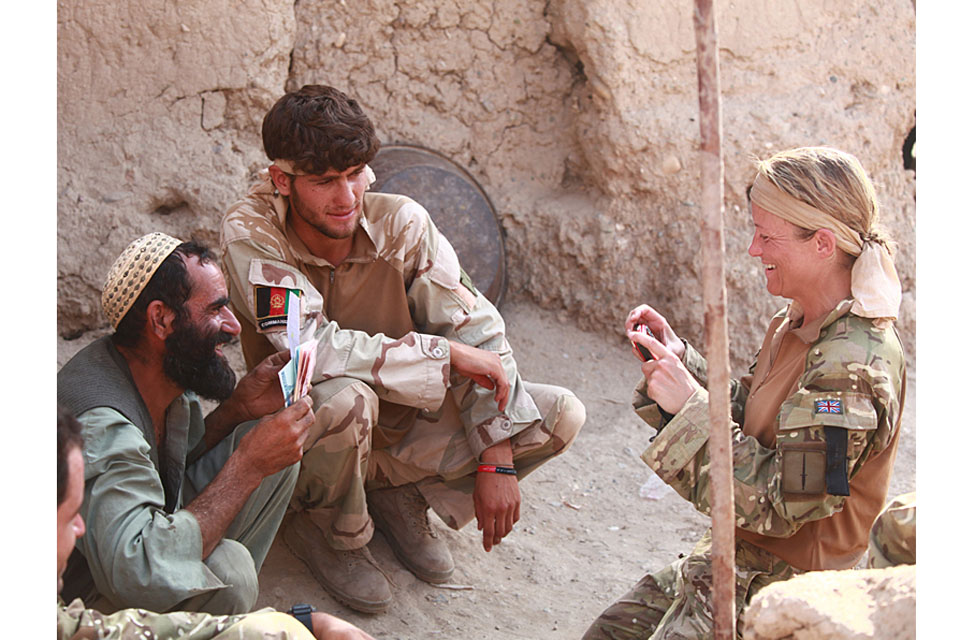 Sergeant Karen Swallow RAF engages with local Afghans while attached to Royal Marines of J Company, 42 Commando, in Helmand province