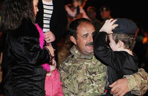Corporal Mark Longdon of 58 Squadron RAF Regiment reunites with his family