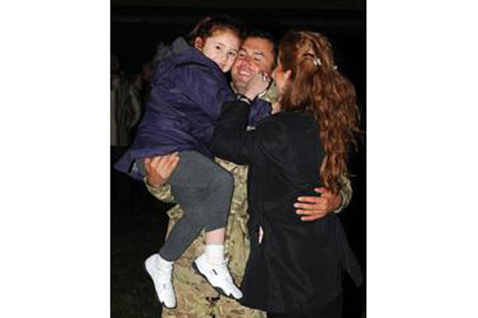 Jason Wozniak of 58 Squadron RAF Regiment reunites with his family