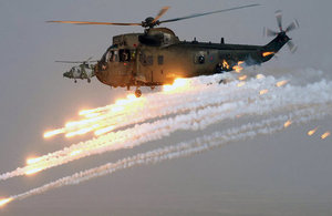 A Royal Navy Sea King Mk4 helicopter of the Commando Helicopter Force (CHF) fires decoy flares.