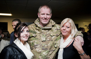 Chief Technician Chadwick is welcomed home by his wife Linda and daughter Kelly
