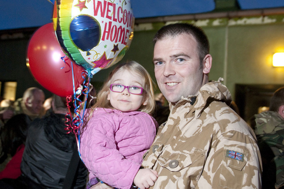 Flight Lieutenant Webster is welcomed home by his daughter