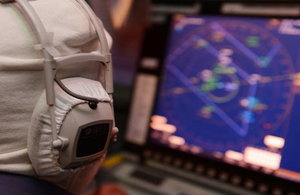 A radar operator in the operations room onboard Type 23 frigate HMS Monmouth.