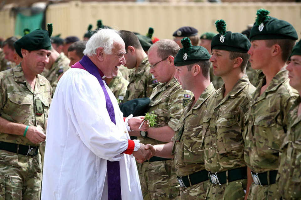 Lord Eames presents a soldier from 1st Battalion The Royal Irish Regiment with shamrocks