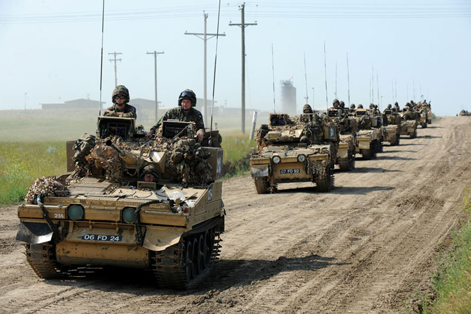 Armoured vehicles from 1st Battalion The Princess of Wales's Royal Regiment on the move during Exercise Prairie Thunder in Canada