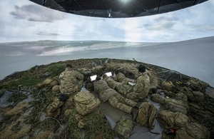 Soldiers inside a simulation tent.