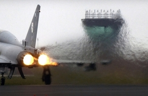 A F2 Typhoon takes off from RAF Coningsby, Lincolnshire creating a heat haze that stretches across the runway.