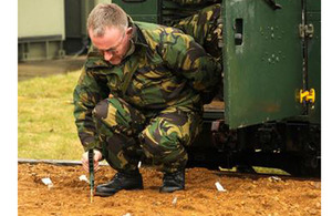 A member of 31 Squadron engaged in counter-improvised explosive device training
