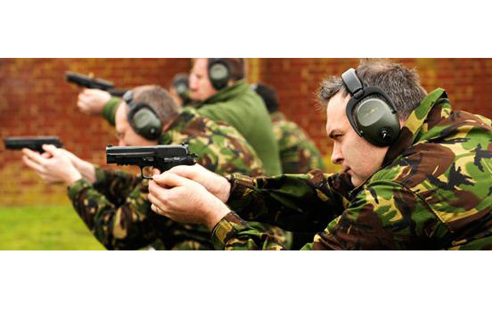 Members of 31 Squadron practise firing pistols