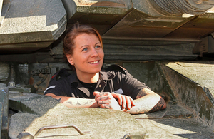 Corporal Rebecca Smith at work inside a Challenger 2 main battle tank